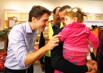 Canada-Headline-News-Now-Syrian-refugees-are-greeted-by-Canadas-Prime-Minister-Justin-Trudeau-L-on-their-arrival